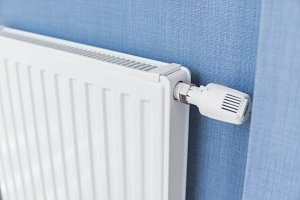 White radiator in an apartment with