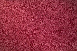 Red carpet texture. Indoor carpeting