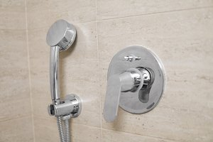 Head of shower in the bathroom close
