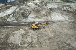 Yellow excavator standing on a