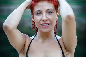 Attractive red hair girl in the natu