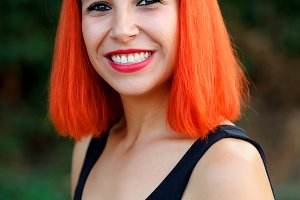 Excited woman with red hair enjoing
