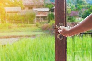 Women hand open door