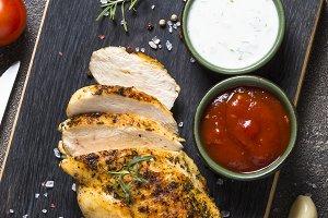 Chicken steak with sauces top view.