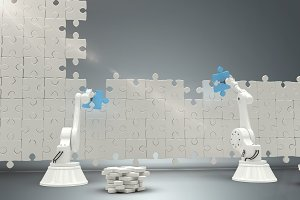 Robots arranging jigsaw pieces