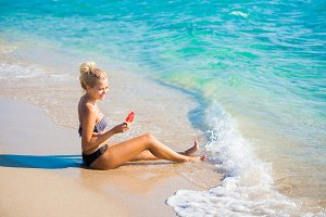 Woman relaxing on the beach on a sum