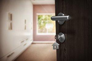 Image of brown door with house key