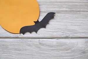 paper bats on the old white wooden