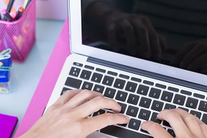 hands of a woman typing