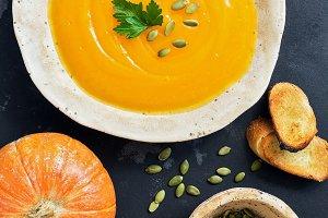 Pumpkin soup in a clay dish