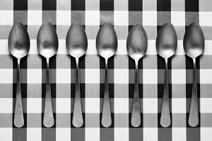 Symmetry of old spoons in black and