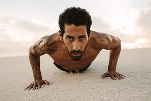 Male athlete doing push ups