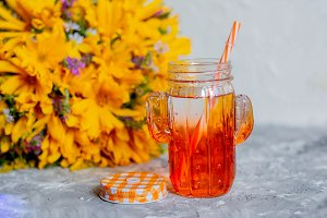 apple juice in a colored glass with