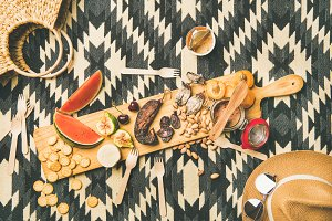 Picnic concept with sausage, fruit