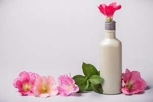 Bottle with cosmetic product and mal