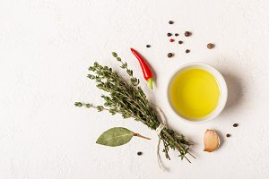 Olive oil and bouquet of thyme on a