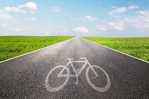 Bike symbol on straight asphalt road