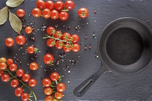 frying pan and  red tomatoes