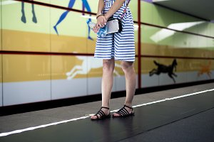 young woman standing on subway stati