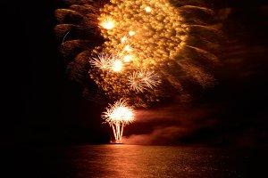 Holiday fireworks above lake