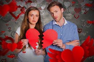 Image of couple holding broken heart