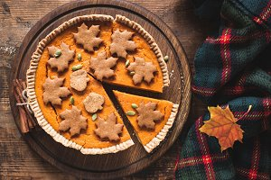 Pumpkin Pie On Wooden Background