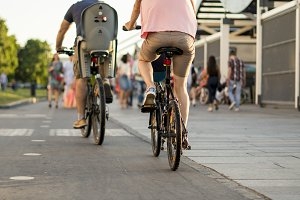 young family riding bicycles in the