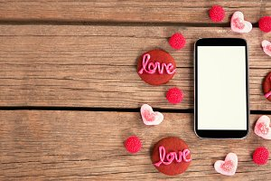 Love sweets around a smartphone