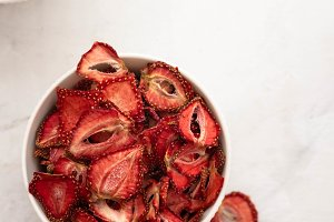 Dried strawberries in a white bowl