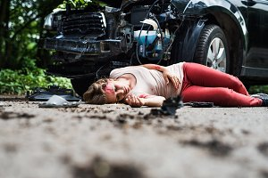 Young injured woman lying on the