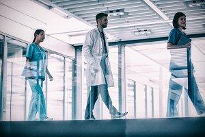 Doctor walking with nurses