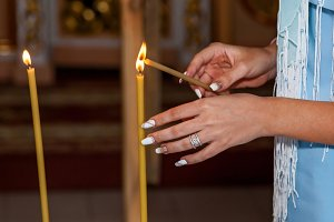 burning wax candles in the church