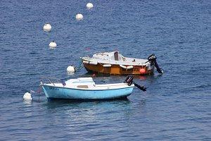 Blue boat orange boat at sea port