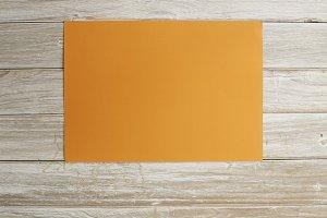 Orange Paper on Old White Wood