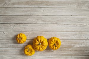 pumpkins on wooden board
