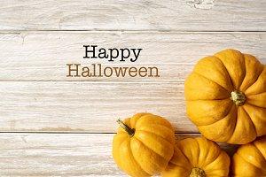 Happy Halloween Pumpkin on the woode