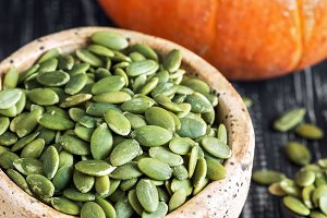 Bowl with green pumpkin seeds