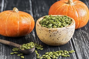 Bowl with raw pumpkin seeds