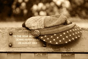 Flat cap left on a bench in the park
