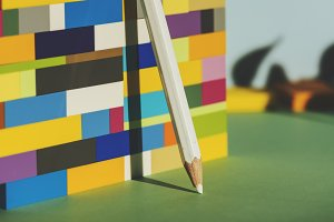 Pencil leaning against the colorful