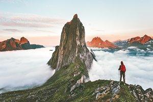 Traveler hiking on mountains ridge