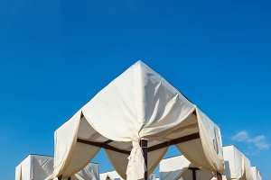 Beach canopies on white sandy beach