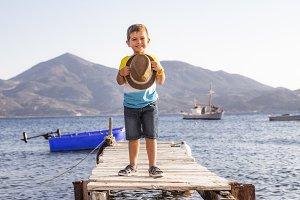 Portrait of a little kid on a dock