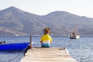 Little boy on a dock