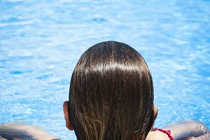 Woman from behind on the pool