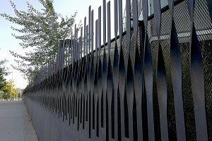 modern metal  fence along the street
