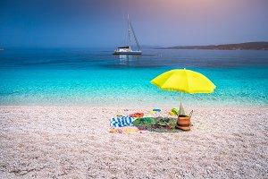Idyllic white beach with green