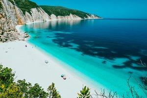 Sunny Fteri beach lagoon with rocky