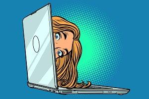 woman peeking out of laptop