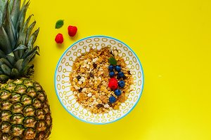 Muesli, pineapple and berries